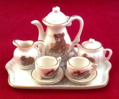 Porcelain Tea Set, 8 Piece Vintage Miniature Porcelain Teddy Bear Tea Set epsteam Not for real tea, but great to underline you're a tea fanatic like me.