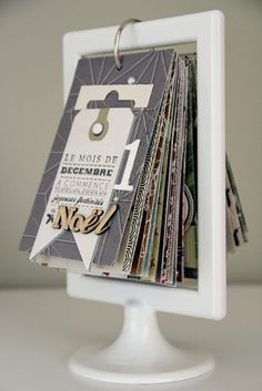 DIY Advent Calendar. Would also be a great way to display photos/photo album, or create an address book/household contacts, doctors, plumbers etc.