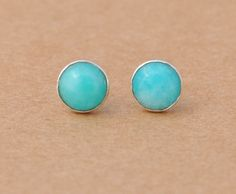 Amazonite is sometimes called Amazon stone and it takes its name from the Amazon River although the stone isnt found in the region. These Amazonite and Sterling Silver earrings are the most incredible light shade of blue. 6mm Amazonite cabochon gemstones with Sterling Silver
