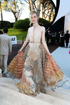 Elle Fanning poses for photographs at the amfAR's 23rd Cinema Against AIDS Gala at Hotel du Cap-Eden-Roc on May 19, 2016 in Cap d'Antibes, France.