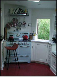 Kitchen with red linoleum floor and baby blue vintage stove Kitchen Corner, New Kitchen, Vintage Kitchen, Kitchen Tips, 1930s Kitchen, Kitchen Ideas, Kitchen Cabinets Decor, Cabinet Decor, Linoleum Flooring
