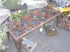 COOL table made of old sprinkler/valve knob thingies ... I really need to learn to weld. Or to find a friend who knows how to weld and has nothing better to do than weld stuff together for me.
