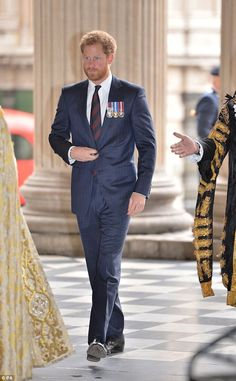 Harry dressed smartly for the occasion in a pin-stripe navy suit, navy and claret striped tie and a white shirt