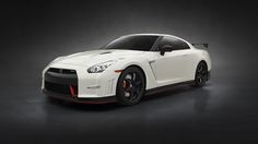 """Among its exhibits, Nissan showcased its GT-R aka """"Godzilla"""" at the Auto Expo The car is dubbed to be the fastest among sportscars in Nissan Gt R, Nissan Gtr Nismo, Porsche Panamera, Porsche 911, Bmw M6, Ferrari 488, Bugatti Veyron, Carrera, Top 10 Sports Cars"""