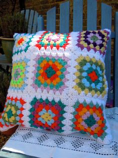 Crochet granny squares cushion by SewnbyScarlet on Etsy, £25.00
