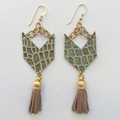These stunning earrings are great for a night out! The hand made calf leather tassels will move with you! www.flordekaronka.com