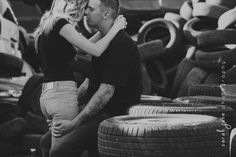 Couple just about to kiss sitting on tires