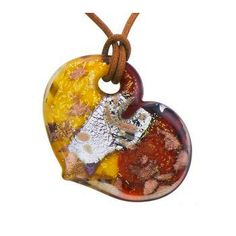 Set at a slight tilt for added interest, this heart-shaped Murano glass pendant dangles on a coordinated cord. The heart is further detailed with foil, a swirl of color, and copper-colored aventurescence. From Venetiaurum Murano Glass Jewelry.