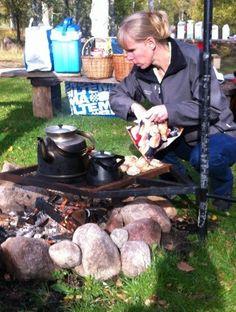 "Malin at Ödevata FiskeCamp preparing the welcome ""fika""."