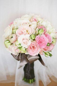 Found on Weddingbee.com - ranunculus, roses, and garden roses.