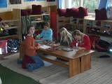 Several pix of movable classroom.  I think 3 to a bench would be to much.  Seeing a different way children sit on the pillows.