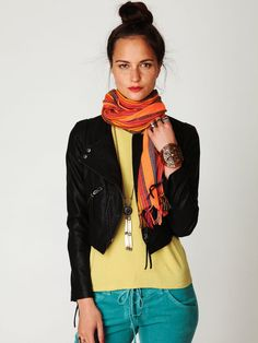 Not really into the pieces as much as the colour combo. Yellow shirt, black jacket, green pants and orange scarf