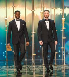 Chadwick Boseman and Chris Evans onstage during the 2016 Oscars