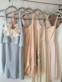Multicolored mismatched bridesmaids dresses in gray, gold, blush, champagne and pink...
