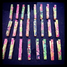 Old Lilly Pulitzer planner pages used to decorate clothespins for hanging photos. So cute! by katina