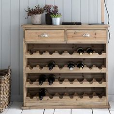 Our Fir Wood wine rack combines a beautifully constructed cabinet with a functional storage unit for your wine. The wooden wine cabinet can store up to 32 bottles so you're sure to never run out. Wine Rack Wall, Wood Wine Racks, Teak Garden Furniture, Rustic Furniture, Wooden Wine Cabinet, Living Room Storage, Wine Cabinets, Wine Storage, Dresser As Nightstand