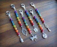These vibrant and fun River Shell key charms are between 4 and 5 inches long and come in 6 varieties: Buddha, Leaf, Dragonfly, Flower, Om/Aum,