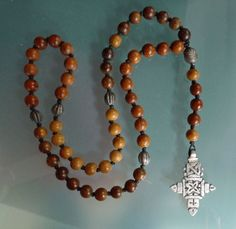 Monk: 10mm Wood beads, India Silver beads and an Ethiopian cross.