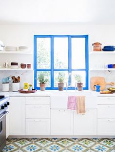 Explore colorful window frame ideas using bright colors of paint, including pinks, blues, and mint green. Check out photos of colorfully painted window frames that will inspire you to paint your own.