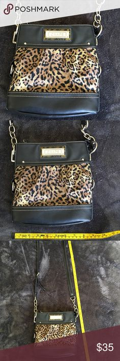 CHAPS animal print Messenger Bag Crossbody Purse Chaps sexy animal print messenger Crossbody Purse.  A lot of space and pockets. Excellent to new condition. Chaps Bags Crossbody Bags
