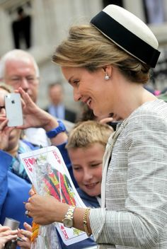 Queen Mathilde of Belgiuam greets her public as she attends mass to remember King Baudouin 7/31/13