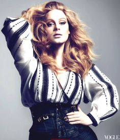 Adele. More people should look up to her. She's not afraid to be herself. And oh yeah..her voice is crazy beautiful!