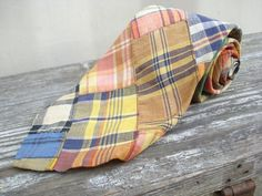 Classic tie from J. Press in cotton Indian Patch madras. Wonderful mix of colorful plaids pieced together make up this material. Madras has been a corner stone of the Ivy League preppy style for quite some time. J. Press is a men's clothier founded in 1902 on Yale University's campus in New Haven, Connecticut. J. Press caters to the old school preppy subculture that eschews popular culture trends.  #JPress #Madras #Necktie #Mens #Tie #Vintage