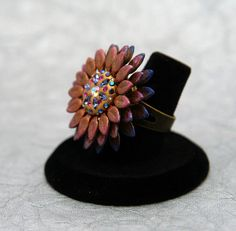 Cool Sunflower Ring -Tanzanite, Amethyst, Light Rose AB, Fuchia, and Clear Swarovski crystals in vintage brass by MoonBubbles on Etsy, $32.50