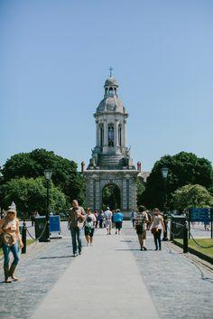 Enjoy a stroll through the courtyard at the historic Trinity College Dublin.