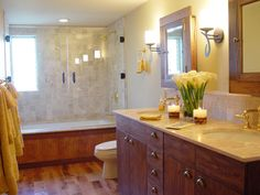 A tub-shower combo, low-maintenance materials, durable fixtures and ample storage are musts for high-traffic bathrooms.