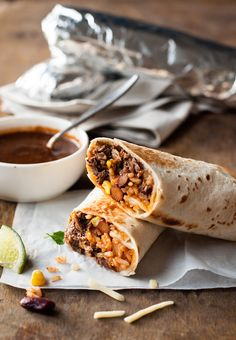 These burritos are stuffed with juicy shredded beef, Mexican red rice and cheese. They are fantastic for freezing!