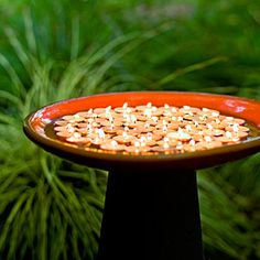 Make your garden glow | Candlelit glow...Float tea candles in a water-filled birdbath to create a mini firepit. On windy days, set tea lights in clear glass votive holders in a dry birdbath so they won't wobble. For my meditation garden.