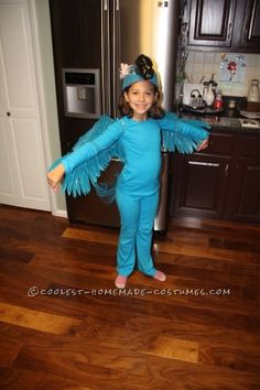 My name is Kaila, I'm 8 years old and made this Blue Macaw (Jewel) costume from the Movie Rio with my grandma and grandpa. First I cut the brim off m...