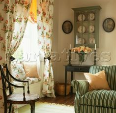 JBH0278: Floral patterned curtains at window seat in - Narratives Photo Agency
