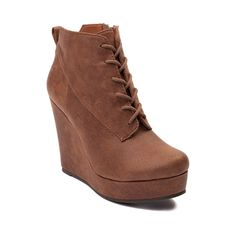 Take cover with the stylish new Hideout Wedge from SHI by Journeys. Stand tall with the Hideout Wedge, rocking an ankle boot design constructed with synthetic suede uppers, and side zipper for easy entry.    Features include   Synthetic suede upper   Lace closure for a secure fit   Side zipper for easy slip-on and off   Heel-pull loop   Wedge 4