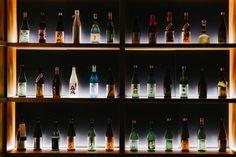 Sake Central Bar in Hong Kong by Sean Dix Retail Interior Design, Japanese Interior Design, Bar Interior, Central Bar, Central Hong Kong, Bottle Display, Wine Display, Japanese Bar, Japanese Culture