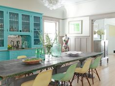 Don't like the chairs, but this is a designer that isn't afraid of bold color.  LOVE the hutch!