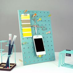 Keep all your bits and bobs safe and tidy on your desk with the Block Mini PegBoard in light Blue! This excellent modern desk memo holder simply stands on your desk and allows you to hang and prop your items on the selection of colourful pegs included.  Each PegBoard has six large pegs and three small pegs that each feature a coloured head for a wonderful presentation when plugged into the holes in the board.  Perfect for holding phones, keys, glasses and any other bits and pieces that you…