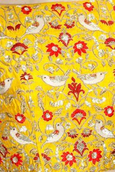 This set features a yellow full sleeves blouse in dupion base appliqued with white thread and sequins embroidered birds and red floral work all over. It has dia Embroidery On Kurtis, Kurti Embroidery Design, Gold Embroidery, Embroidery Fashion, Embroidery Dress, Couture Embroidery, Embroidered Bird, Embroidered Blouse, Salwar Kameez