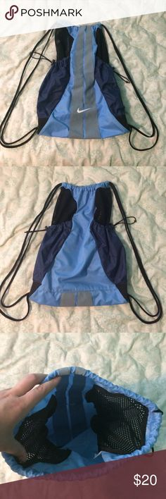 Nike Drawstring Bag Very spacious, never used, no flaws, great condition. Has 2 adjustable pouches on the side, great for water bottles! Nike Bags
