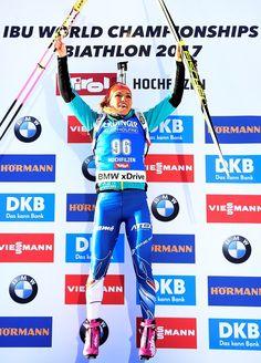 Gabriela Koukalova of Czech Republic celebrates on the podium after winning the Women's 7,5 km Sprint race during the 2017 IBU Biathlon World Championships in Hochfilzen, on February 10, 2017.    / AFP / FRANCK FIFE