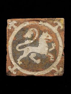 Tile, red earthenware with an impressed design of a lion and infilled with white slip and covered with a clear lead glaze. From Keynsham Abbey in Somerset. English, second half century. Medieval World, Medieval Art, Tile Art, Mosaic Tiles, Medieval Furniture, Animal Rug, Antique Tiles, Encaustic Tile, Renaissance Paintings