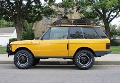 This 1983 Range Rover is the hard to find two-door model with the trick door handles. It is nicely prepared with a good stance and protection, and the Camel Trophy yellow works but the original white might look even better.