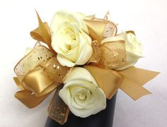 Gold and ivory wrist corsage by Ballard Blossom. Prom and wedding flowers, Seattle