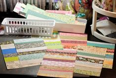 """You'll be amazed at how quickly this goes – in no time at all, you'll have several sheets of """"new"""" paper. I probably spent 10 or 15 minutes and came up with these (and notice all the scraps I have left over in the baskets!)…"""