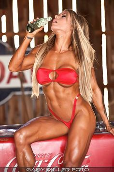 IFBB Pro figure competitor Larissa Reis posing her fit body for Gary Miller Foto.