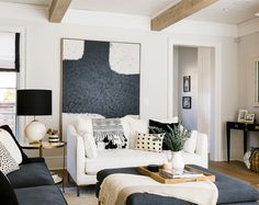 modern neutral living room with oversized artwork Inside a Colorful Denver Home With European-Inspired Style