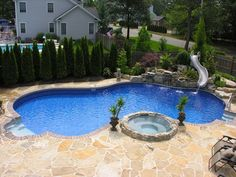 Pool Town Natural Spring Pool with Waterslide and attached Hot Tub