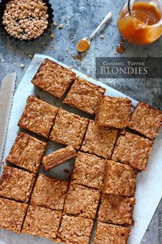 The BEST blondies you'll ever eat. With a nutty toffee base, chewy caramel center and a light crunchy top, all in the most buttery-moist blondie ever! Yummy Cookies, Yummy Treats, Sweet Treats, Bar Cookies, Cookie Bars, Brownie Recipes, Cookie Recipes, Dessert Recipes, Eat Dessert First