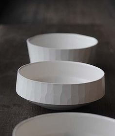 Porcelain bowls. Modern version of army/mess-kit inspired dishes